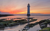 Lighthouse at sunset near the mossy coast wallpaper 1920x1200 jpg