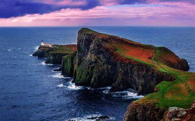 Lighthouse on rocky shore wallpaper