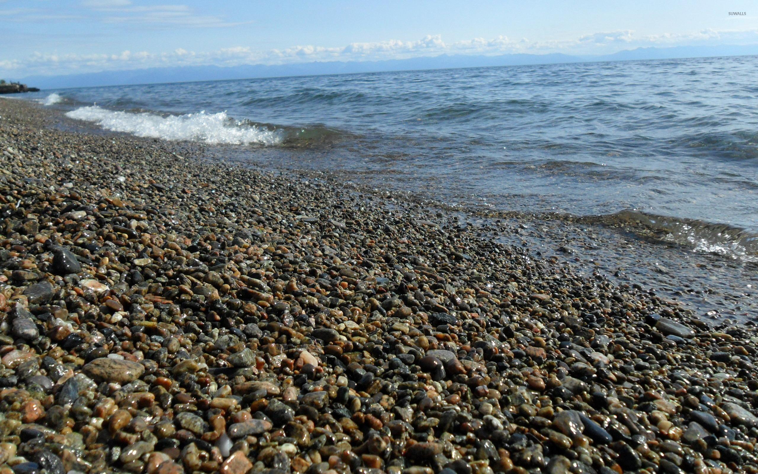 Pebble Beach At The Ocean 2 Wallpaper