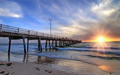 Pier towards the golden ocean sunset Wallpaper