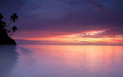 Purple sunset at white sandy beach wallpaper