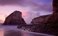 Purple sunset over the high rocky shore wallpaper 2560x1600 jpg