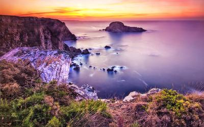 Purple sunset over the ocean wallpaper