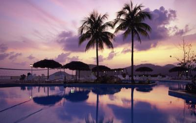 Purple sunset over the resort wallpaper