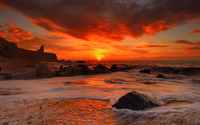 Red sunset above the rocky beach wallpaper 1920x1200 jpg
