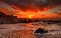 Red sunset above the rocky beach wallpaper 1920x1200 jpg
