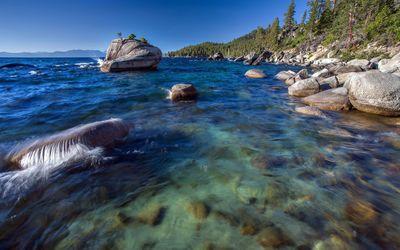 Rocks in the blue ocean water wallpaper