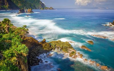 Rocks in the ocean near the exotic island wallpaper