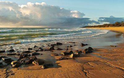 Rocks on sandy beach wallpaper