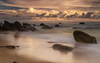 Rocks rising from ocean water to the beautiful sunset wallpaper 1920x1200 jpg