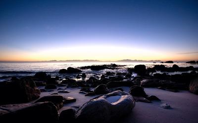 Rocky beach at sunset wallpaper