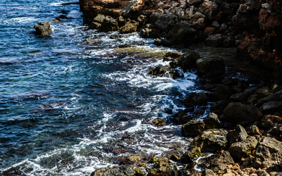Rocky coast in Cala de la Higuera wallpaper