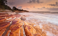 Rusty rocks washed by the foamy ocean waves wallpaper 1920x1200 jpg