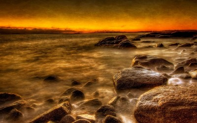 Rusty sunset at the rocky beach wallpaper