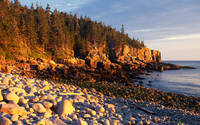 Rusty sunset light reflected upon the rocky shore wallpaper 2880x1800 jpg