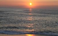 Sun shining over the ocean wallpaper 2560x1600 jpg