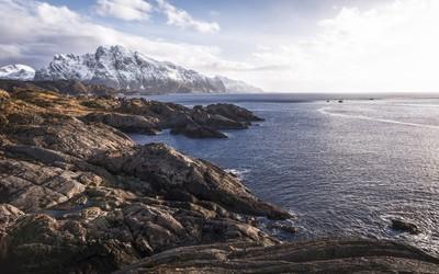 Sunny winter day over the rocky ocean cliffs wallpaper