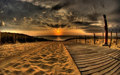 Sunset above the wooden boardwalk wallpaper