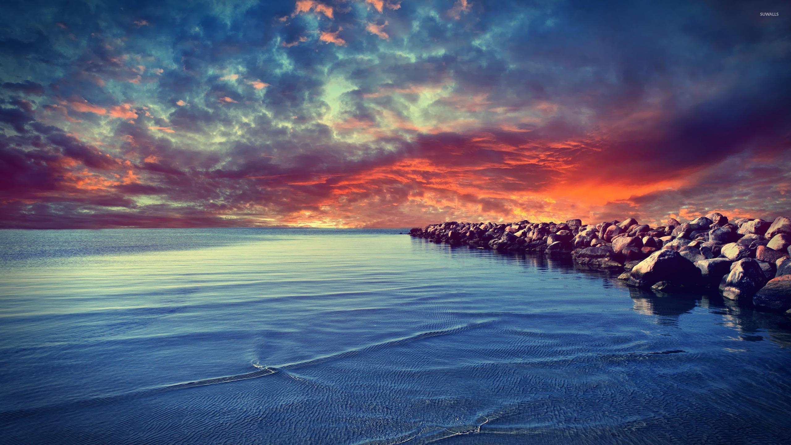 Sunset Over The Rocky Beach Wallpaper
