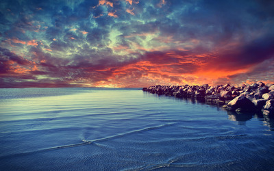 Sunset over the rocky beach wallpaper