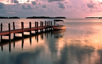 Sunset reflected in the calm ocean water by the pier wallpaper 2560x1600 jpg