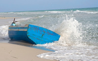 Waves splashing on a blue boat on the beach wallpaper 1920x1200 jpg