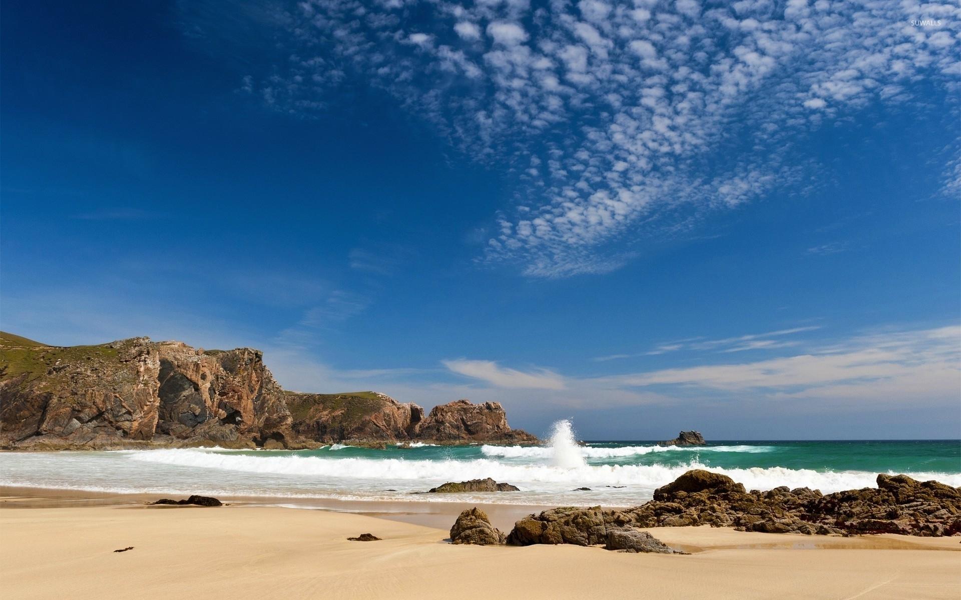 Sandy Beach Wallpaper: Waves Splashing On A Sandy Beach Wallpaper