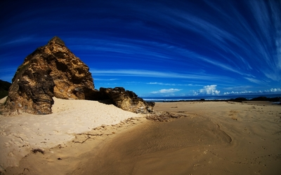 White trails on the blue sky above Valla Beach wallpaper