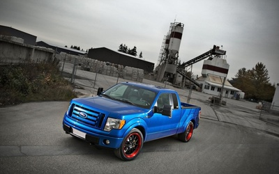 2009 Blue Ford F-150 front side view wallpaper