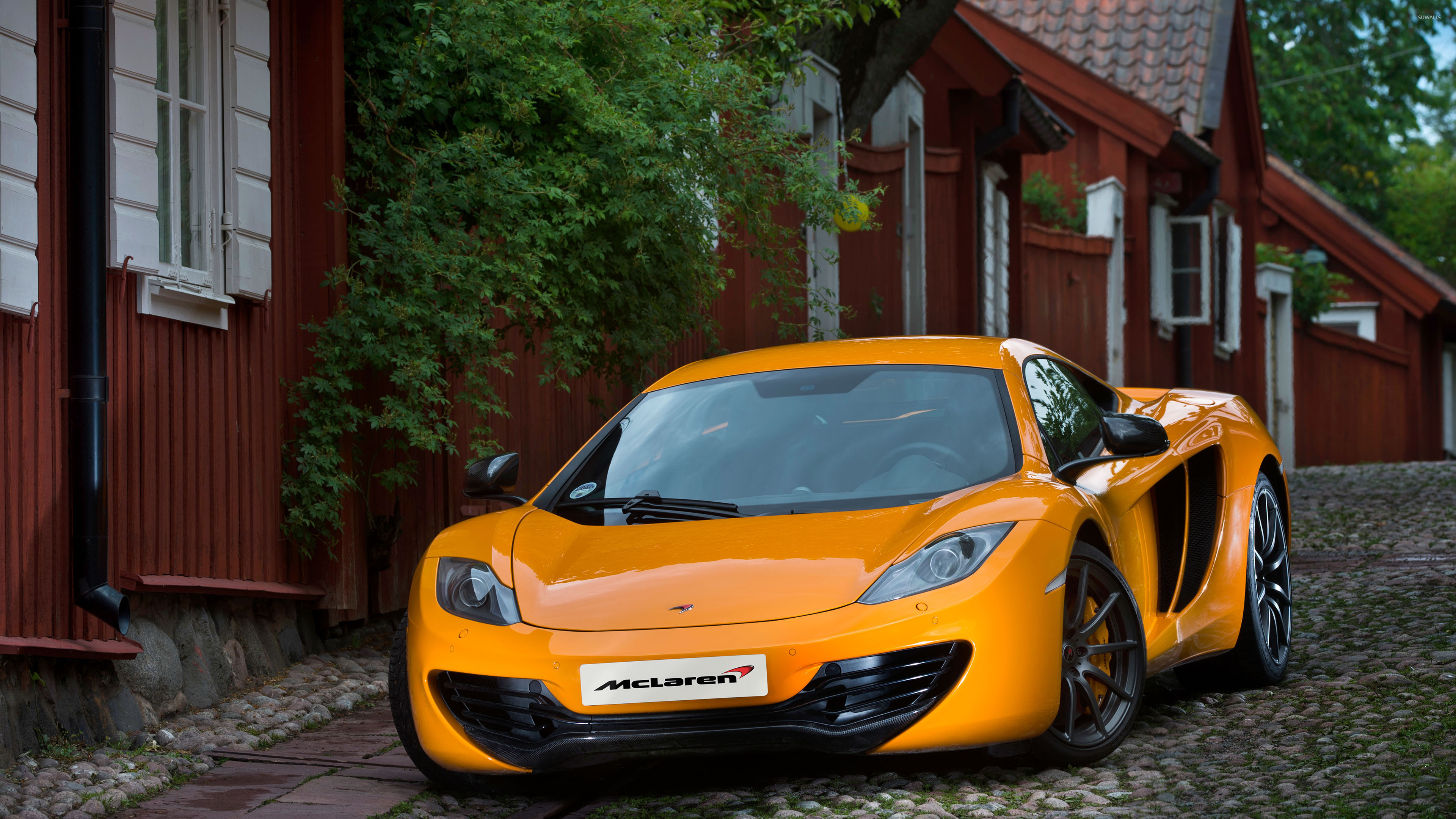 2013 orange mclaren mp4 12c front view 50563