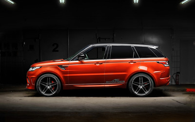 2014 AC Schnitzer Land Rover Range Rover side view in a warehous Wallpaper