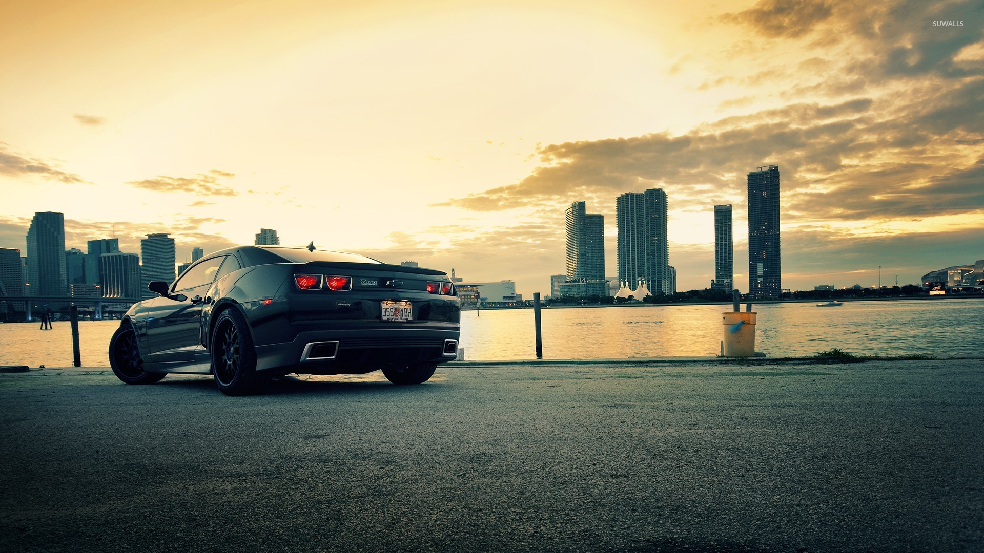 Back Side View Of A Chevrolet Camaro At Sunset Wallpaper