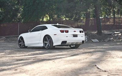 Back side view of a white Need 4 Speed Chevrolet Camaro SS wallpaper