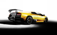Back side view of a yellow Lamborghini Murcielago wallpaper 1920x1200 jpg