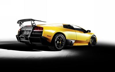 Back side view of a yellow Lamborghini Murcielago wallpaper