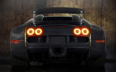 Back view of a Bugatti Veyron with stop lights on wallpaper