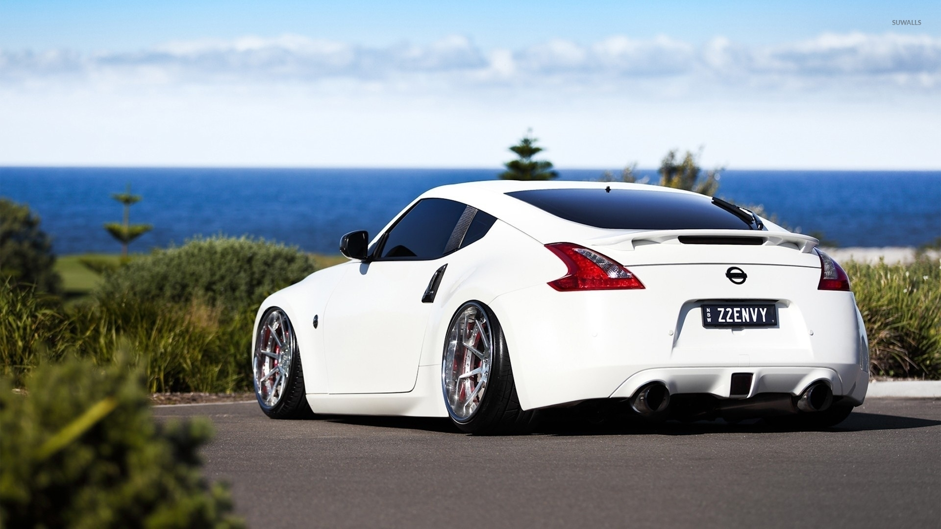 Back View Of A White Nissan 370Z Wallpaper