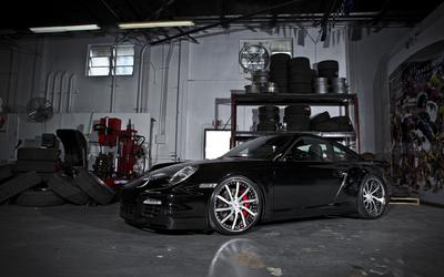 Black 2011 Porsche 911 Carrera in a garage wallpaper
