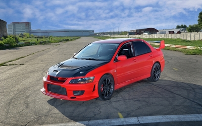 Black and red Mitsubishi Lancer Evolution wallpaper