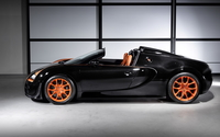 Black Bugatti Veyron with orange rims side view wallpaper 1920x1200 jpg