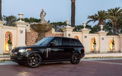 Black STRUT Land Rover Range Rover parked in a garden wallpaper