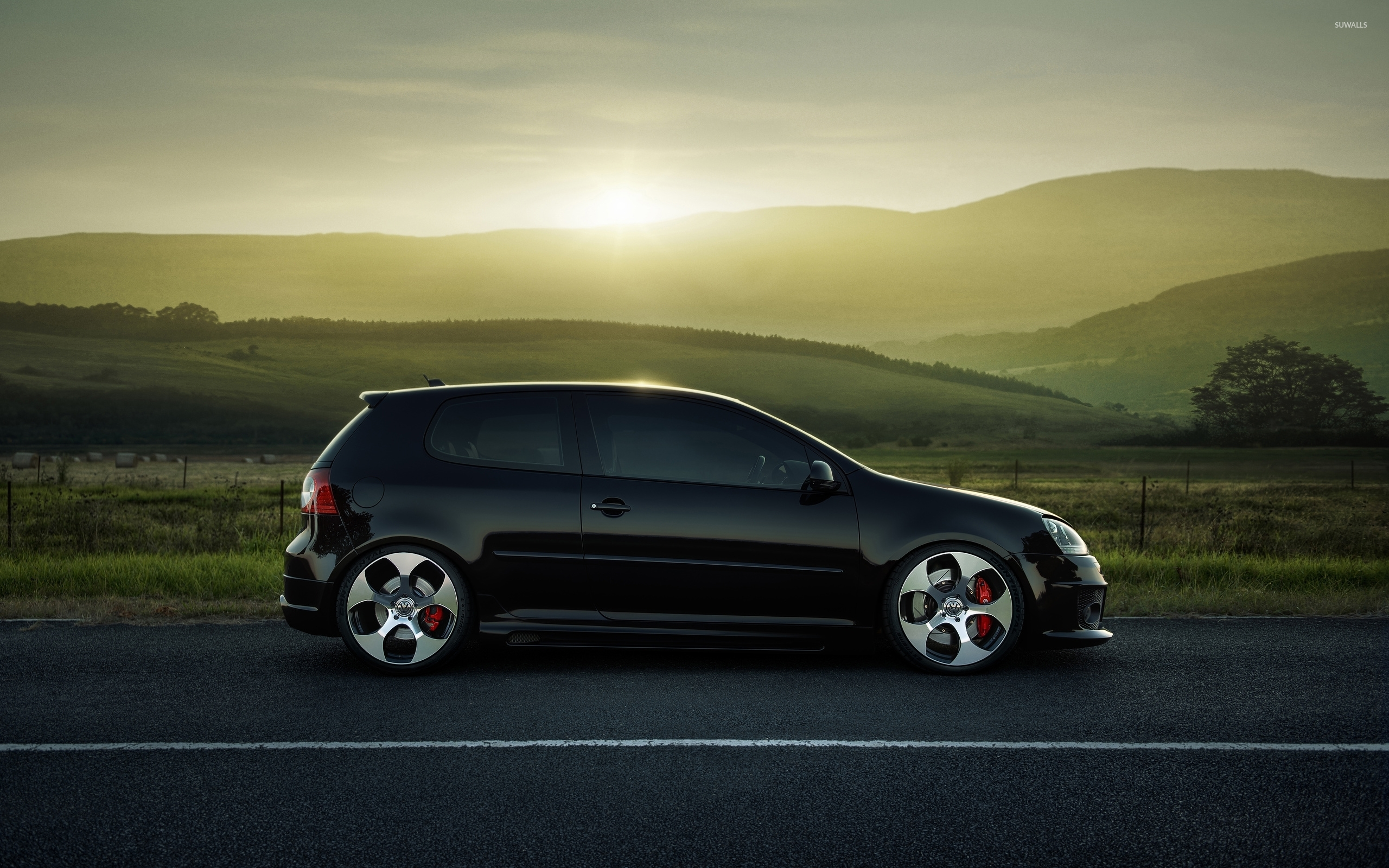 Black Volkswagen Golf Mk5 On The Road Side View Wallpaper