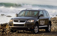 Black Volkswagen Touareg TDI Clean Diesel on a rocky beach wallpaper 1920x1200 jpg