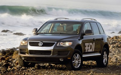 Black Volkswagen Touareg TDI Clean Diesel on a rocky beach wallpaper