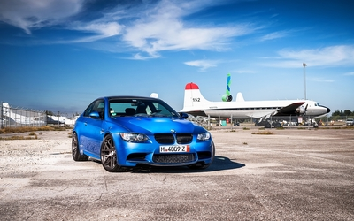 Blue BMW M3 near an airport wallpaper