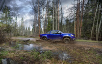 Blue Chevrolet Colorado Z71 racing through muddy forest path wallpaper 2560x1600 jpg
