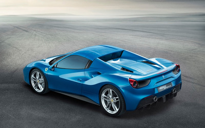 Blue Ferrari 488 Spider with top on wallpaper