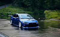 Blue Mitsubishi Lancer Evolution in the water wallpaper 1920x1200 jpg