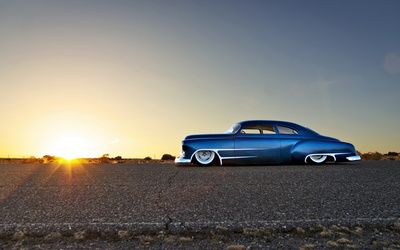 Blue sparkly Chevrolet lowrider side view wallpaper