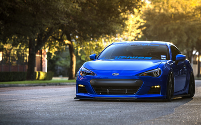 Blue Subaru BRZ on the road wallpaper
